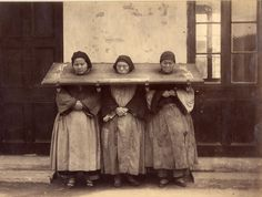 Chinese Women in a Cangue, c. 1880. Extremely lugubrious they are locked together by a wooden frame and pad-locks.