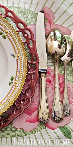 """Silver monogrammed flatware from Christofle . . . 'We use that monogram on everything, from our linens to our stationery,' [Penny Drue Baird] says. As formal French table etiquette dictates, flatware faces downward."" Manhattan apartment of designer Penny Drue Baird. Design by Penny Drue Baird. Photography by John Bessler. Written by Krissa Rossbund. ""Saint-Tropez-Inspired Dinner"" produced by Erin Swift. Traditional Home."