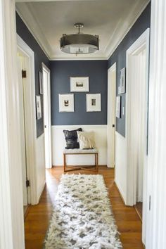 Home sweet Home Love this idea for decorating in a hallway! Navy upper walls white lower and a Love this idea for decorating in a hallway! Navy upper walls white lower and a small bench with pillows and picture frames at the end of the hallway. House Design, Hallway Decorating, Home Goods, Interior, Home, House Styles, Decor Inspiration, House Interior, Interior Design