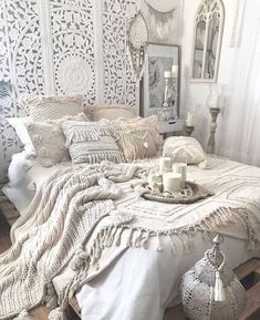 an all white Moroccan bedroom with an ornate wodoen screen, crochet pillows and .-- an all white Moroccan bedroom with an ornate wodoen screen, crochet pillows and blankets, candles and lanterns and dream catchers Stylish Bedroom, Cozy Bedroom, Dream Bedroom, Modern Bedroom, Bedroom Beach, Bohemian Bedroom Decor, Boho Room, Bohemian Living, Moroccan Bedroom Decor