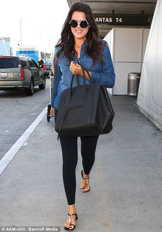 Khloe Kardashian wearing The Row Round-Frame Acetate and Metal Sunglasses Giuseppe Zanotti Buckled Sandals Celine Boston Bag Le Specs Ding A Ling in Black and Gold with Smoke Mono Lenses