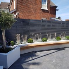 Contemporary fencing slats can be used to construct modern clean style screens or fences in your garden. These look great painted grey. Photo courtesy of CMA Garden Design Contemporary Fencing, Contemporary Garden Design, Home Garden Design, Backyard Garden Design, Backyard Patio, Patio Fence, Contemporary Architecture, Backyard Ideas, Garden Ideas