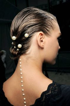 """Sam McKnight's Statement Hair Chanel To evoke Karl Lagerfeld's underwater theme, McKnight fashioned pearl-adorned chignons: """"I wanted it to look as if the girl had just risen from the sea."""" McKnight, Pantene Pro-V's global stylist, combed a mix of mousse and conditioner into hair, gathering lengths at the nape, then twisted them into a bun and secured it with pins."""