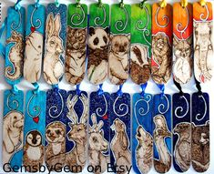 Lots of wooden bookmark, pyrographed freehand straight into the wood and finished with glitter emulsions and colour blends. Available here:  www.etsy.com/uk/shop/GemsbyGem