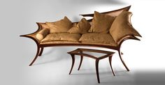A stunning and sophisticated Chaise Lounge, made of honduras rosewood and intricate canework, intended for indulgent relaxing
