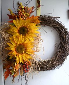 Fall autumn sunflower wreath with raffia yellow leaves berries