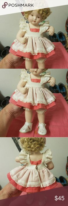 """Vintage Shirley Temple Doll from Royal Heirloom 11"""" ROYAL HEIRLOOM COLLECTION PORCELAIN SHIRLEY TEMPLE DOLL in EXCELLENT CONDITIONNo cracks, chips,blemishes or dirt. The 11"""" doll has a full porcelain body, unlike many other collector dolls. She has blonde hair, light brown eyes, andis wearing a dress with apron, bloomers & Mary Jane white shoes. Marked on back of neck. Excellent condition for any collection, make offer. NOW TAKING PAY PAL, Great Xmas gift. Other"""