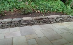 ... Custom Stonescaping stacked stone retaining wall, flagstone patio, asphalt driveway with granite edging ...