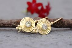 Gold Diamond Earrings Solid Gold Earrings Champagne | Etsy Exquisite, antique-style champagne diamond and 14k, 18k or 22k solid gold hook drop earrings, ethnic boho chic jewelry gift. These amazing drop earrings have a decorated rustic disc and a champagne diamond set in the middle of it. At the bottom of the disc on each earring, there are three gold dots that add character to these boho earrings.