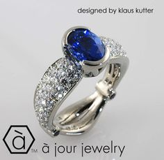 An incredible ring I created for a customer!  Semi-Bezel set high-quality Blue Sapphire, pave' diamonds on a tapered band all set in rich 18kt Palladium White Gold!*