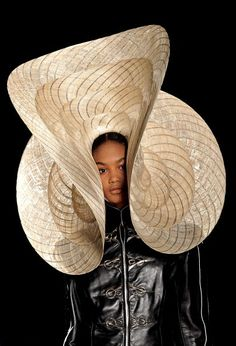 A model showcases designs on the catwalk by Philip Treacy