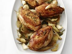 Garlic-Roasted Chicken from FoodNetwork.com  If you love roasted garlic and juicy chicken--this is for you!