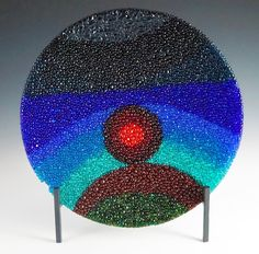 """Sedona Sunset Fused Glass Raindrop Bowl  This 13"""" raindrop bowl is an abstract frit ball painting of a Sedona Sunset."""