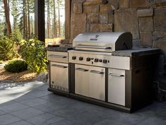 The outdoor kitchen comes equipped with a gas grill large enough to feed a crowd, plus custom countertops and a built-in refrigerator. - Outdoor Kitchen Pictures From HGTV Dream Home 2014 on HGTV