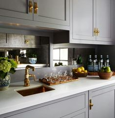 Kitchen Remodeling Trends Mirror Backsplash Ideas That Aren't From the or Mirror Backsplash Kitchen, Kitchen Countertops, Kitchen Cabinets, Backsplash Ideas, Gray Cabinets, Backsplash Wallpaper, Black Backsplash, Beadboard Backsplash, Kitchen Mirrors