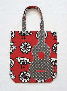 This is a bright handmade tote bag (book bag) with an appliquéd ukulele motif. The body is made from red Clothkits birds & apples print cotton fabric (designed by Jane Foster), the appliqué uke is cut from a piece of grey polka dot cotton. Apple Prints, Tote Bags Handmade, Patchwork Bags, Fabric Bags, Shopper, Ukulele, Bag Making, Fabric Design, Printing On Fabric