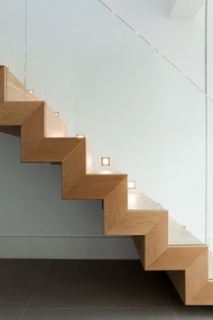 pale wood staircase, glass wall railing
