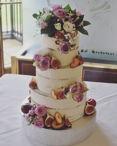 Yesterday's semi-naked wedding cake @stockbrookcountryclub decorated with fresh figs and plums + pretty flowers supplied by @casablancaflorist