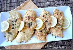 Skinny+Chicken+Piccata  1/4+cup+++1+tsp.+all-purpose+flour 8+(3+oz)+thin+boneless,+skinless+chicken+cutlets 1/8+tsp.+salt 1/8+tsp.+pepper 2+Tbsp+canola+oil 2+Tbsp+capers,+rinsed 2+medium+garlic+cloves,+minced 1+cup+low-sodium+chicken+broth 1/2+cup+dry+white+wine 4+(2-inch)+strips+lemon+zest 4+tsp.+fresh+lemon+juice 1+Tbsp+unsalted+butt