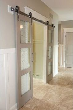 Idea for office doors.  Also like the wainscoting Bentley Design , you can reach them at 727-631-2882