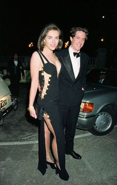 The actress and model Elizabeth Hurley in her most vivacious looks by Versace.
