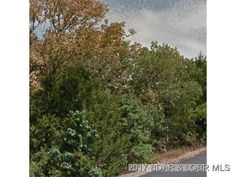 Nice Building Lot on HH. Mostly Wooded with great highway frontage and Four Seasons amenities in Lake Ozark MO