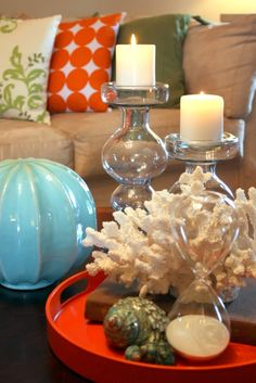 Coral, shells & candles with orange, green & turquoise accents. Brown Couch Living Room, New Living Room, Orange And Turquoise, Turquoise Accents, Coral Colour Palette, Living Room Turquoise, Shell Candles, I Love Lamp, My Ideal Home