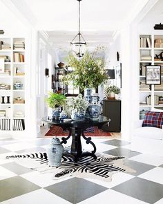 Don't know what to do with an empty foyer?  Add a round table in the middle with blue and white china vases to create a focal point.  Have your guest stop linger and marvel at your beautiful vases.