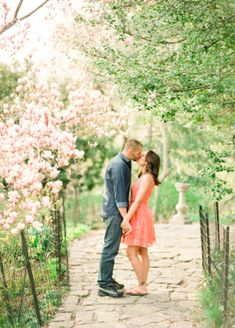 Couple Kissing Beneath Cherry Blossoms   photography by http://www.lindsaymaddenphotography.com/