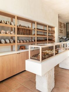 Los Angeles studio Commune has used plaster walls, wood built-ins and terracotta tile floors to create a rustic feel inside this bakery in Santa Monica. BreadBlok is a bakery founded by Chloé Charlie Cafe Santa Monica, Terracotta Floor, Gluten Free Bakery, Bakery Design, Bakery Interior Design, Cafe Design, Design Design, Showroom Interior Design, Design Interiors