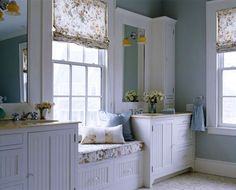 I love this Country bathroom with the window seat between the 2 sinks