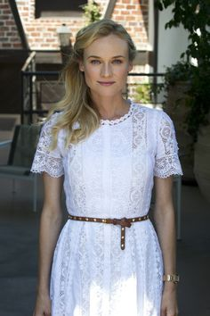 Diane Kruger. White lace dress (this dress is all about the lace so gorgeous.... add a ribbon around the waist and lengthen the dress..... i think the dress would be a beautiful wedding gown..