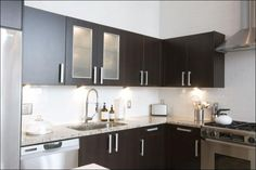 White Subway tile w/ espresso cabinets. (dislike the thick handles though, would prefer sleek)