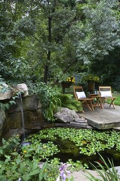 Small platform deck over stone pond with waterfall.  From http://jglassandassociates.com (found it on houzz.com)