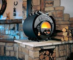 These unique wood burning stoves are handcrafted in Germany and have simple yet very effective design. The Energetic Bullerjan stove features cylindrical horizontal combustion chamber [. Small Wood Burning Stove, Solid Fuel Stove, Small Wood Stoves, Wood Burning Heaters, Contemporary Wood Burning Stoves, Modern Stoves, Pellet Stove, Wood Stove Heater, Gas Stove