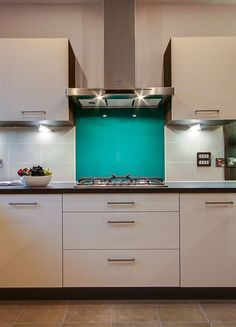 Add a splash of colour to a neutral kitchen with a bright blue splash back, adding a fun, modern feel to your kitchen.