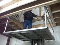 How to build a pole barn with a loft workshop ideas for Garage apartment plans with elevator