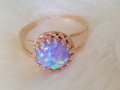 Fire Opal Glass Stone on a Daisy RIng. Description from etsy.com. I searched for this on bing.com/images