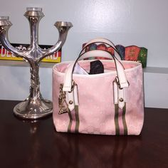 Authentic Gucci mini Pink mini Gently used. Can send more pics to email if needed. Goes with matching Gucci mule in my closet (size 8 fit 7). Gucci Bags Mini Bags