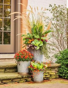 Mums don't feel quite as common when grouped with other containers. Details + more ideas for decorating with mums: http://www.midwestliving.com/garden/flowers/outdoor-fall-decorating-with-mums/?page=3
