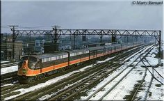 Bedecked in all matching colors, the southbound City of Miami departs Chicago led by E9A #4036 on a cold March day in 1964.