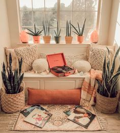 This Dallas home has boho decor, plenty of desert, southwestern elements and gorgeous natural light. We love the bright green elements in the bedroom, the geometric tile in the bathroom and the woven wicker furniture throughout. #recordplayer #sunroom #indoorplants #snakeplants