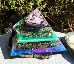 A one of a kind large Orgonite Crystal Pyramid for energetic balancing and to inspire the grace of transformation in your life. Hand crafted with love and Reiki attuned, the Violet Flame Orgone Butterfly Crystal Pyramid is a powerful Feng Shui tool. Orgone is another word for the subtle, yet powerful energy of creation. Modern environmental and emotional pollution can wreak havoc on our body, mind and Spirit, and Violet Flame Orgone seeks to even the energetic scales with every piece…