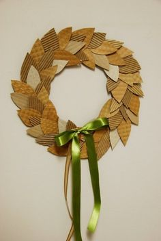 An easy, economical project for kids: This wreath can be made any size, costs virtually $0 to make. Textured cardboard repurposed from coffee cup holders and other corrugated paper add visual interest.