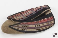 Culture/People:probably Potawatomi [Oklahoma] (attributed)  Object name:Moccasins  Date created:circa 1890  Place:Oklahoma; USA  Media/Materials:Hide, silk ribbon  Techniques:Sewn, ribbonwork appliqué  Collection History/Provenance:Collected by Mark Raymond Harrington (1882-1971, MAI staff member) in 1908 or 1909 during fieldwork sponsored by George Heye.