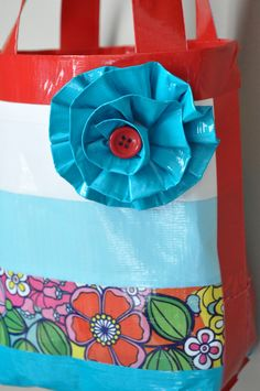 Duck Tape Pleated Flower Tutorial! I did the flower, it is super cute and super easy!! Check out the link because she has a great way of doing the bottom of duct tape bags!!