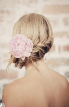 Combine braids and a flower pin to add glamour to any updo.