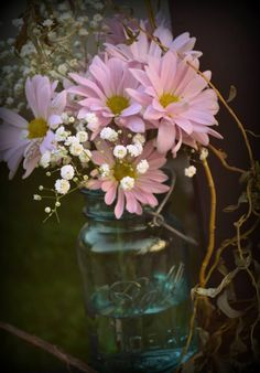 I love flowers in mason jars! I used it for graduation and we have so many!