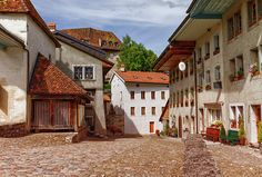 Houses In Gruyeres Village, Fribourg, Switzerland by Elenarts - Elena Duvernay photo Places In Switzerland, Famous Places, Travel Photos, Fine Art America, Street, House, Beautiful, Travel Pictures, Home