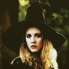 Stevie wearing a witch's hat; her heavy eye makeup and black shawl completes this dramatic look   ☆♥❤♥☆